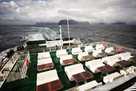 ship deck: Empty sundeck on a ferry sailing between Faroe Islands Stock Photo
