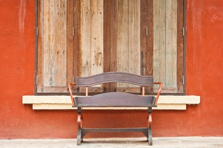 wooden chair with windows on Italian style building  photo
