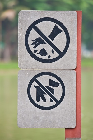 No dogs allowed and No littering sign at park  Stock Photo - 9937669