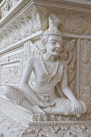 Ascetic statue in Thai style molding art at temple  photo