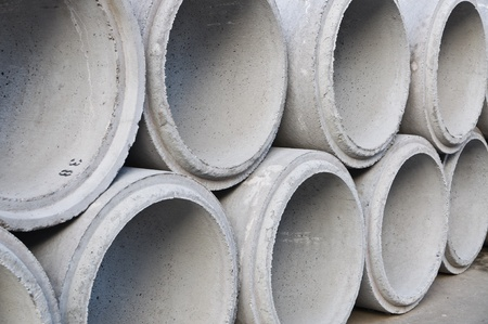 Concrete drainage pipes stacked on construction site  photo