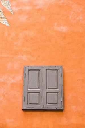 Window on orange cement wall  photo