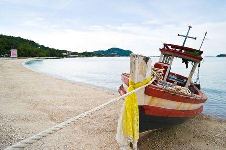 wood fishing boat on beach  photo