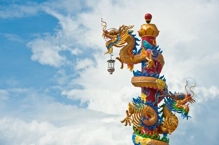 festival scales: Dragon statue on pillars with blue sky