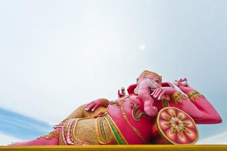 chachoengsao: Pink ganecha statue in relaxing at Wat Samarn, Chachoengsao, Thailand  Editorial