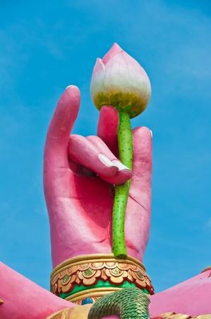 siddhivinayaka: Hand of Pink ganecha statue in relaxing at Wat Samarn, Chachoengsao, Thailand