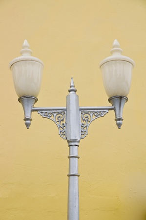 Thai style lamps with yellow background photo