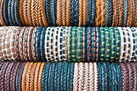 crafted: Leather bracelets shown for sale on red