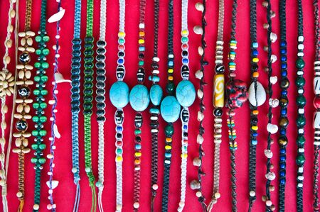 crafted: Bracelets shown for sale on red