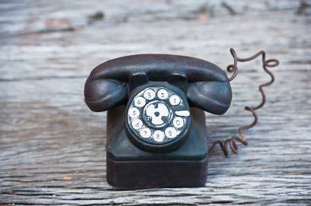retro phone: ceramic phone on wood