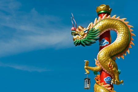 the red dragon: Dragon in chinese temple with blue sky