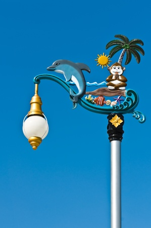lamp on the pole: Hanging lantern dolphin and monkey in traditional Thai style