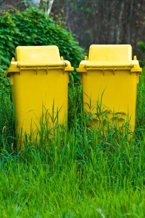 trashcan: two yellow public trashcan