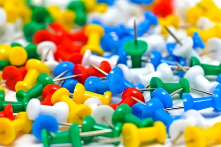 noteboard: Group of colorful push pins on cork bulletin board Stock Photo