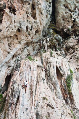 Mountain climber, Rai Lay cliff, south of Thailand  Stock Photo