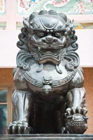 Bronze lion in chinese temple photo