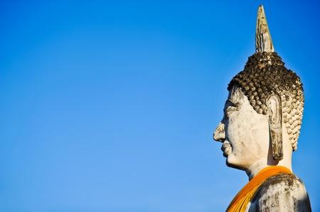 chaimongkol: Buddha Status at Wat Yai Chaimongkol with Blue Sky, Ayutthaya, Thailand