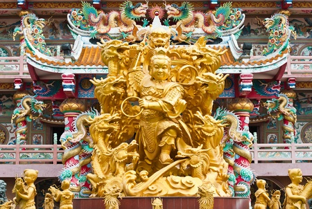 golden statue at chinese temple photo