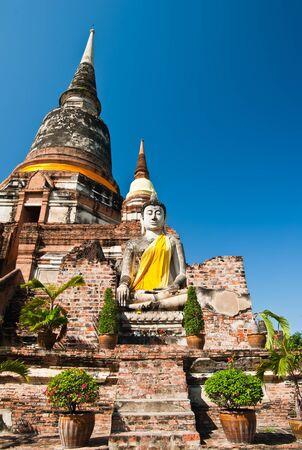 Buddha Status and Pagoda at Wat Yai Chaimongkol, Ayutthaya, Thailand  photo