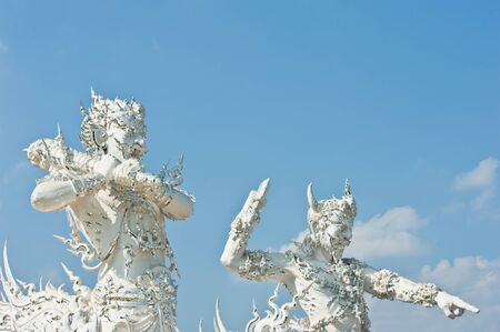 nether: Two Giants in White Church of Wat Rong Khun at Chiang Rai, Thailand