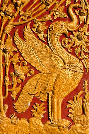 Golden Wood Carving Pattern in Traditional Thai Style  photo