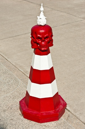 Red and White Traffic Cone with Red Skull  photo