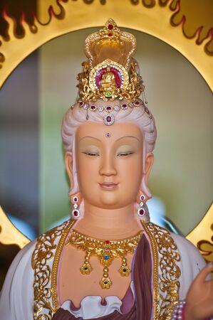 The guan yin buddha statue  photo