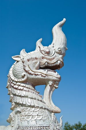 King of White Naga with Blue Sky in Temple, Thailand  photo