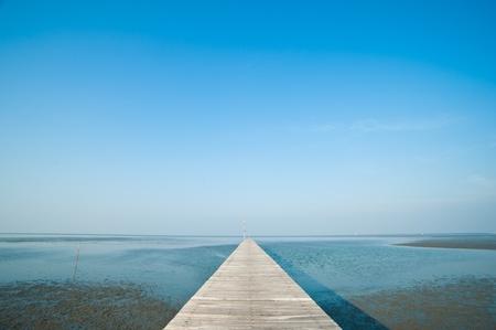 Wooden Pier in Thai Sea  photo