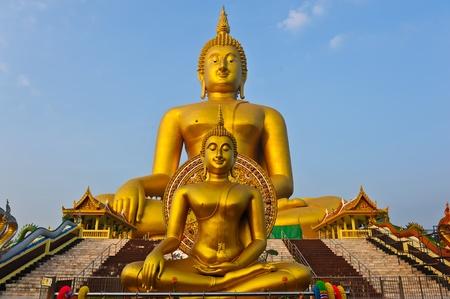 Golden Buddhas at Wat Muang, Ang Thong Province, thailand  photo
