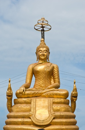 Golden statue of Buddha on the hill in Phuket island, Thailand  photo