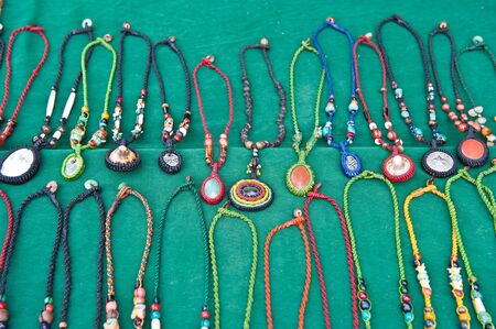 crafted: Necklace shown for sale at market, Thailand