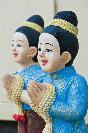 Thai boy and girl sculpture for Sawasdee welcome of thailand  Stock Photo - 11107103
