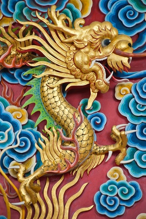 Golden dragon statue in chinese temple, Thailand  photo