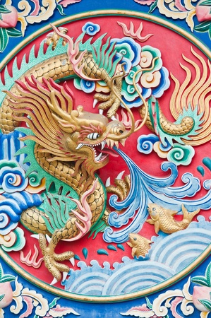 Golden dragon spit water  photo