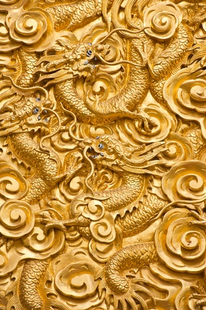 Golden dragons sculpture in chinese temple, Thailand
