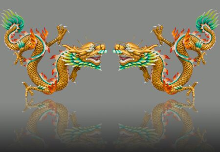 Twin golden dragon statues