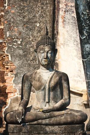 Buddha image in Wat Saphan Hin at Sukhothai Historical Park, Thailand  photo