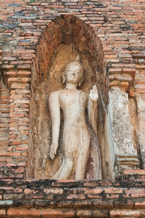 Buddha images in Wat Mahathat at Sukhothai Historical Park, Thailand  photo