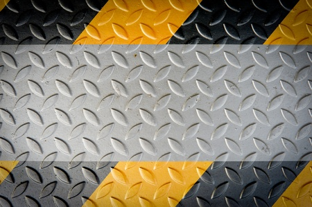 Yellow and black warning sign on Metal Plate Stock Photo - 11298230