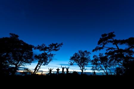 Four men on a top of a mountain photo