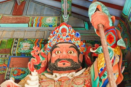 Guardian Demons at the Gates of Buddhist Sinheungsa Temple in Seoraksan National Park, South korea photo