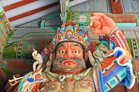 Guardian Demons at the Gates of Buddhist Sinheungsa Temple in Seoraksan National Park, South korea Stock Photo - 11309809