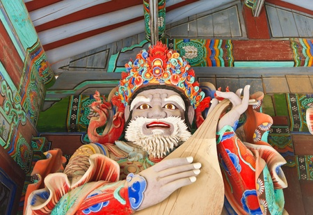 Guardian Demons at the Gates of Buddhist Sinheungsa Temple in Seoraksan National Park, South korea photo