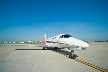 corporate jet: Business plane parked at the airport Stock Photo