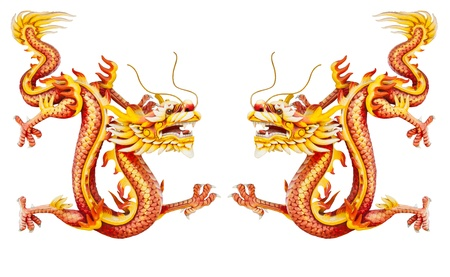 Twin golden dragon statues on white background Stock Photo