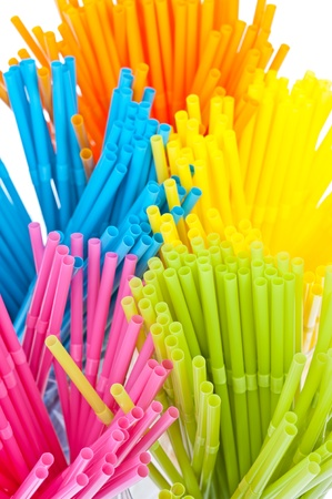 Colorful drinking straws isolated on white background photo