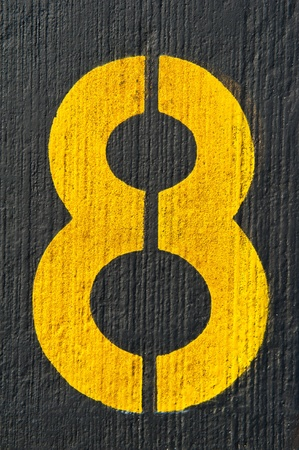 Number eight painted on black floor - check my portfolio for other numbers photo