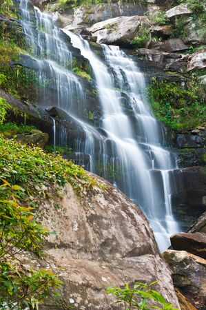 Khunphong Waterfall in deep jungle, Phu Kradueng National Park, Loei Province, Thailand photo