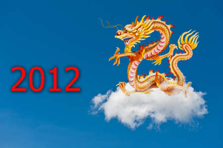Dragon flying on a fluffy cloud across a blue sky with 2012 photo